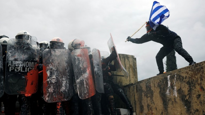 Athens police fire tear gas at protesters -  VIDEO