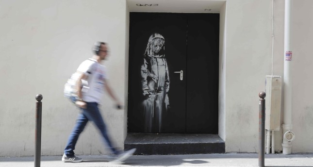 Thieves steal door with Banksy mural from Bataclan nightclub in Paris