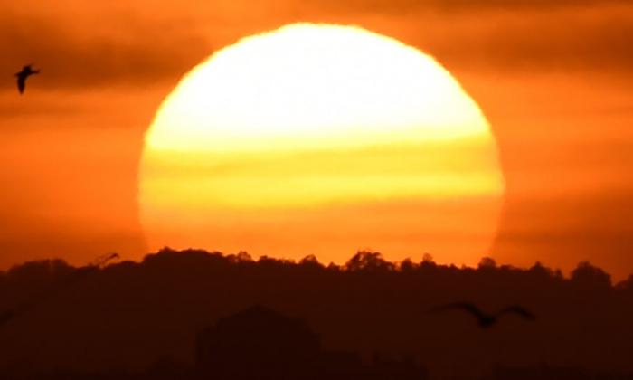 Australia extreme heatwave: records broken for highest minimum temperatures