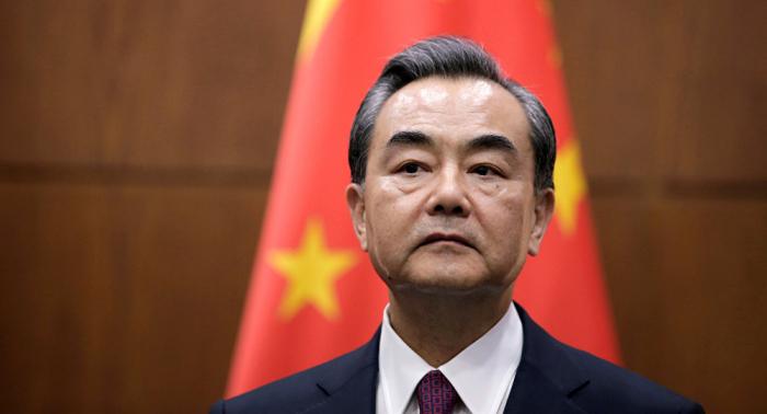 Canciller chino llama a lograr lo antes posible un acuerdo comercial con EEUU