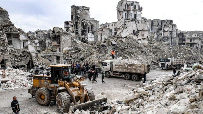 Syria war: Aleppo building collapse kills 11