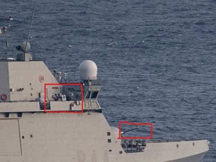 Spanish warship with guns manned orders boats in Gibraltar to leave