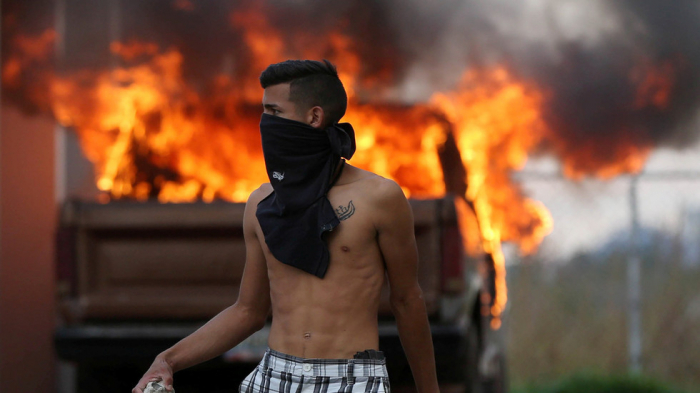 Venezuela crisis: Border clashes, 'masked thugs', 'torched aid' & fake Red Cross-  VIDEOS