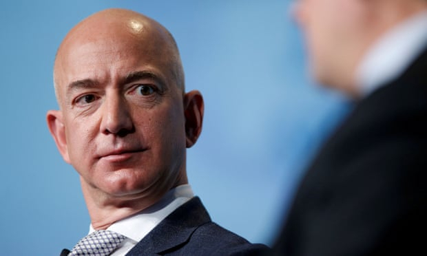 Jeff Bezos accuses National Enquirer owner of