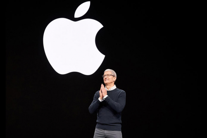 With iPhone sales slowing, Apple bets on video, gaming, news and a credit card