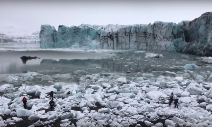 Glacier collapse sends large wave towards shore-  NO COMMENT