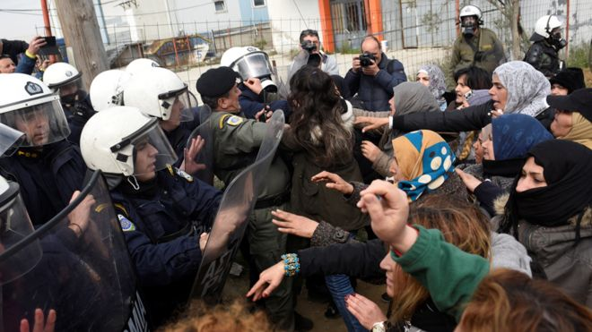 Greek police clash with migrants after