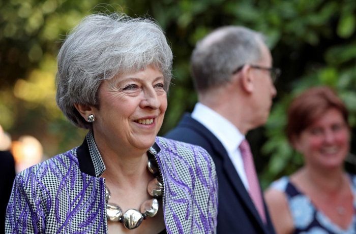 Britain wants Brexit deal approved before July - May