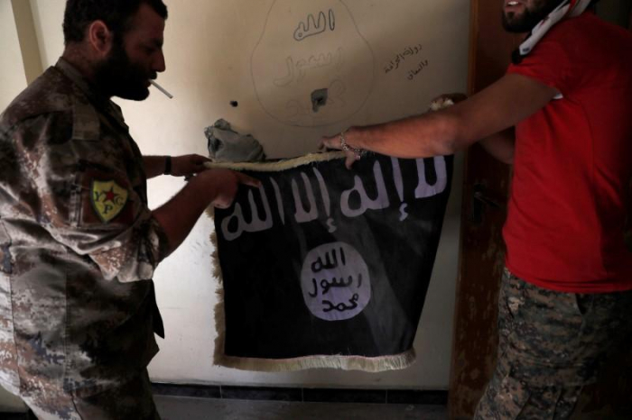 Iraq court sentences four to death for joining IS