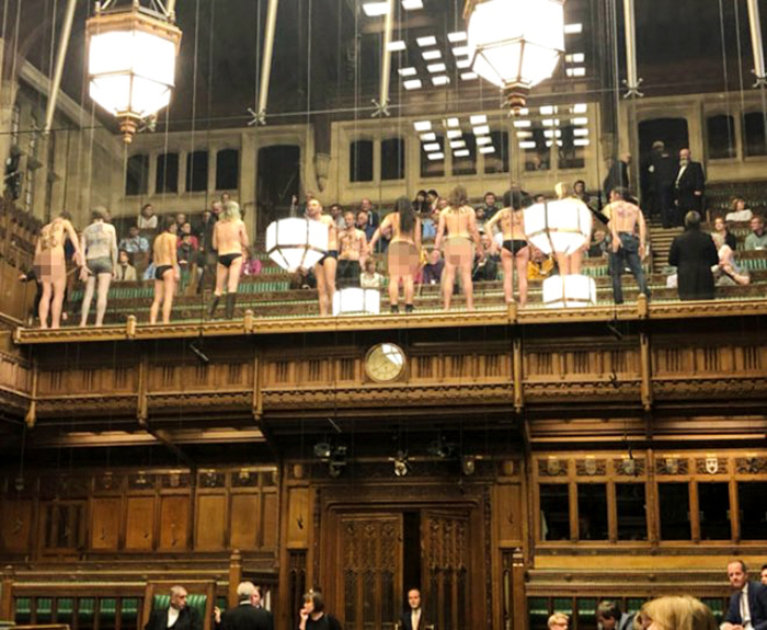 Protesters bare almost all to U.K. Parliament, which can't look away