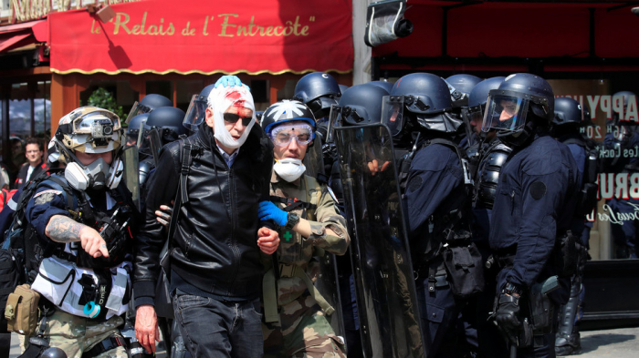 Tear gas fired during May Day demonstrations in Paris, scores detained -  VIDEO