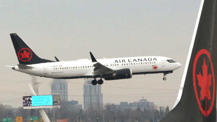 Air Canada plane collides with fuel truck on runway, 3 injured