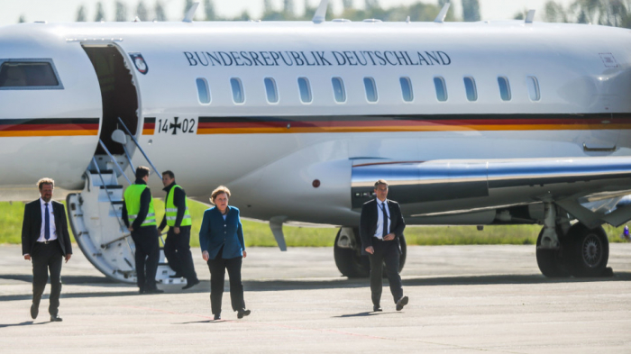 Merkel forced to swap planes again as van rams her jet