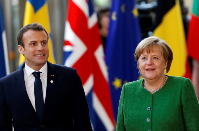 Macron, Merkel seek common ground on EU Commission president pick