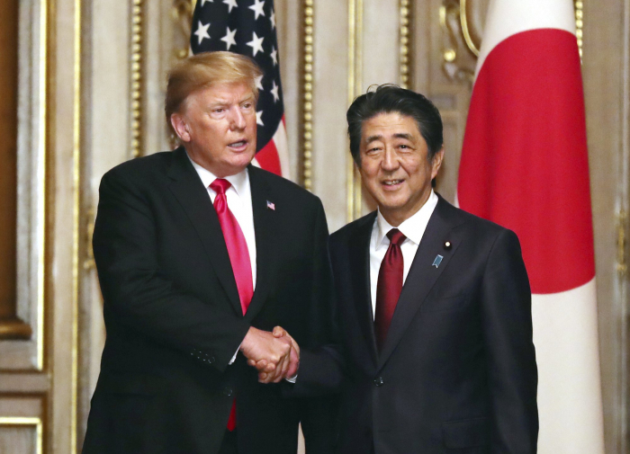 The Latest:   Trump says US not ready for China trade deal