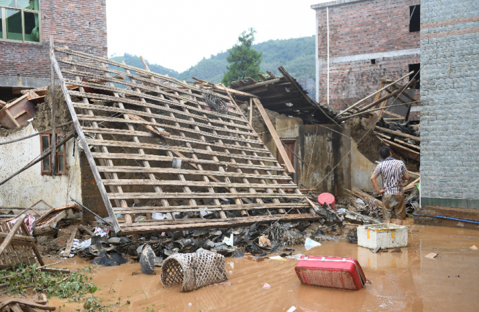 Heavy rain leaves 13 dead, 2 missing in China