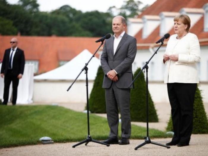Merkel und Scholz betonen Stabilität durch Grundsteuer-Einigung