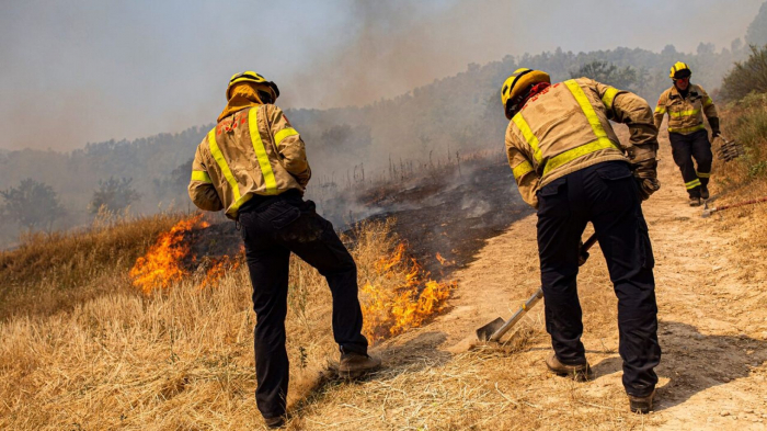 2 die, wildfire rages in Spain amid widespread heatwave