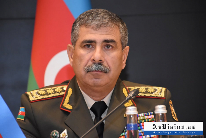 Azerbaijani defense minister watches military parade in Minsk