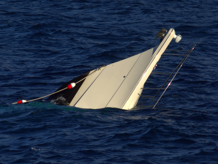 Boat with more than 70 migrants capsizes off coast of Tunisia