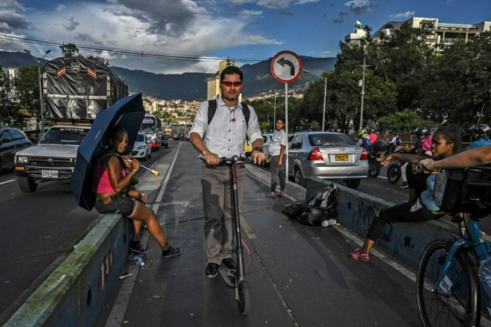Electric scooters zip into traffic chaos in Latin America