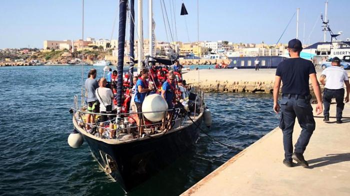 Italy migrants: New charity ship docks despite ban