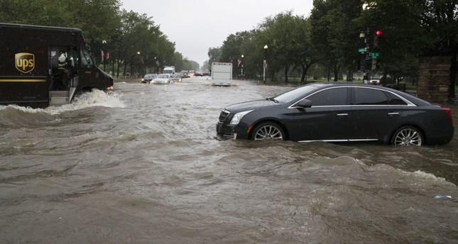 Heavy rains strand Washington drivers, flood White House basement