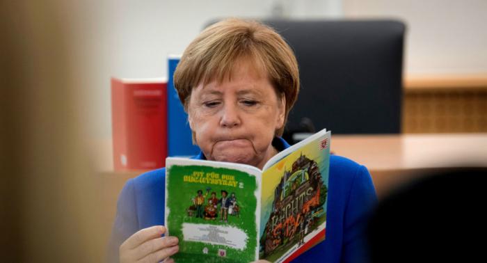 Lippenleserin lüftet, was Merkel beim dritten Zitteranfall vor sich hinflüsterte
