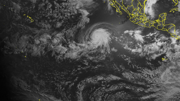 A satellite captured a powerful hurricane and a solar eclipse at the same time
