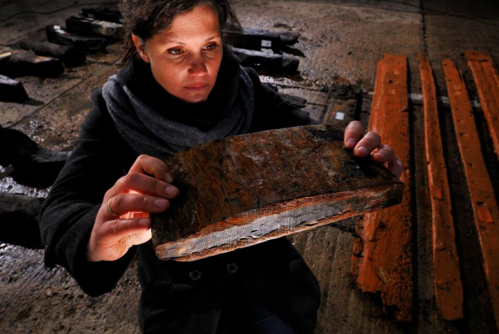 How are tree rings used to help date an archaeological site?