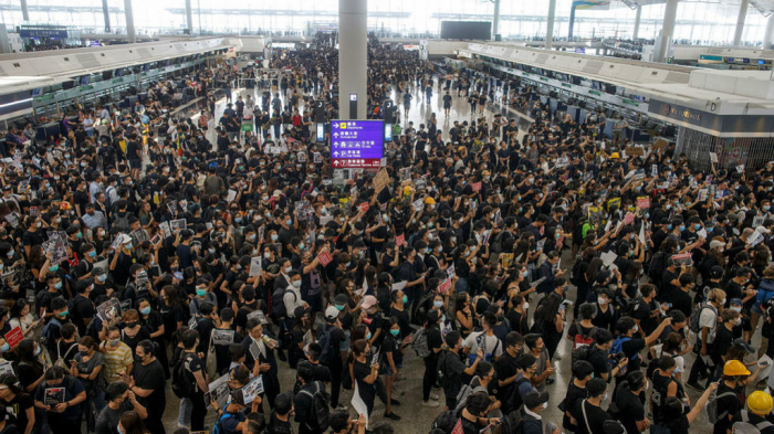 Hong Kong cancels all remaining flights as 5,000 protesters occupy airport - UPDATED