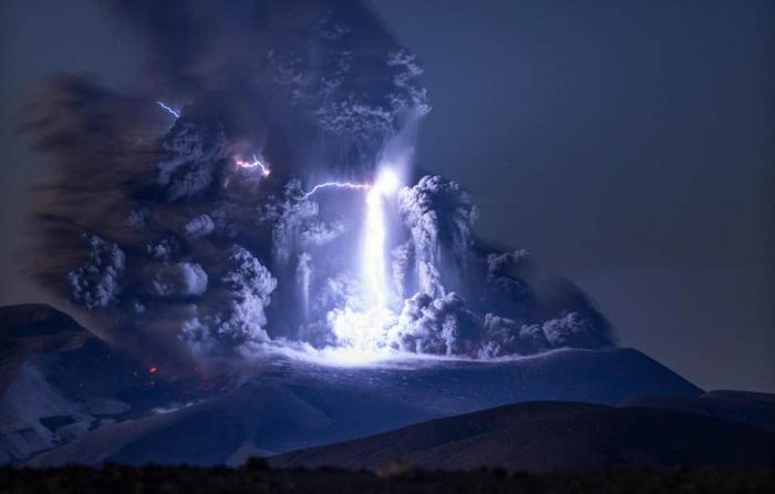Lightning bolt strikes erupting volcano in extraordinary image