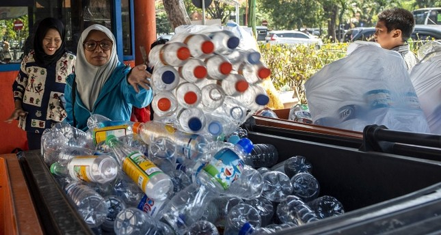 Indonesians swap bottles for travel tickets on