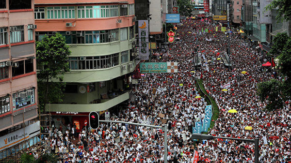 Tens of thousands of Hong Kongers join anti-government rally