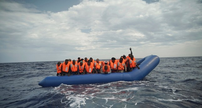 50 migrants saved from sinking boat off Libya