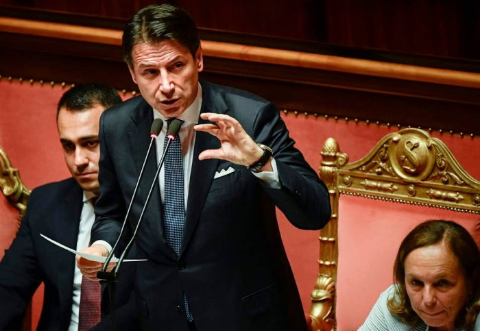 Italy's new coalition government approved after close senate vote