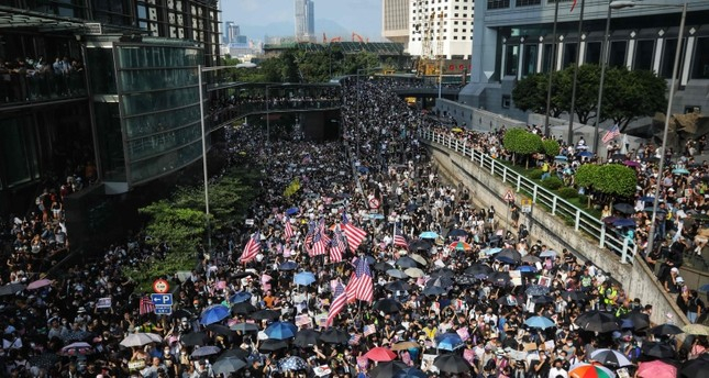 Thousand march to US consulate in Hong Kong in bid to receive int
