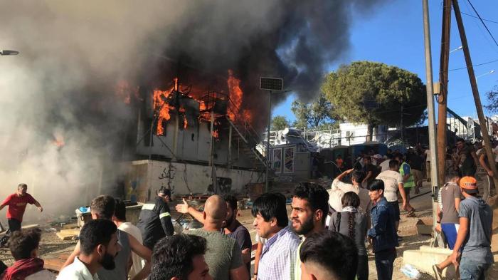 Fire breaks out inside refugee camp on Greek island, two dead