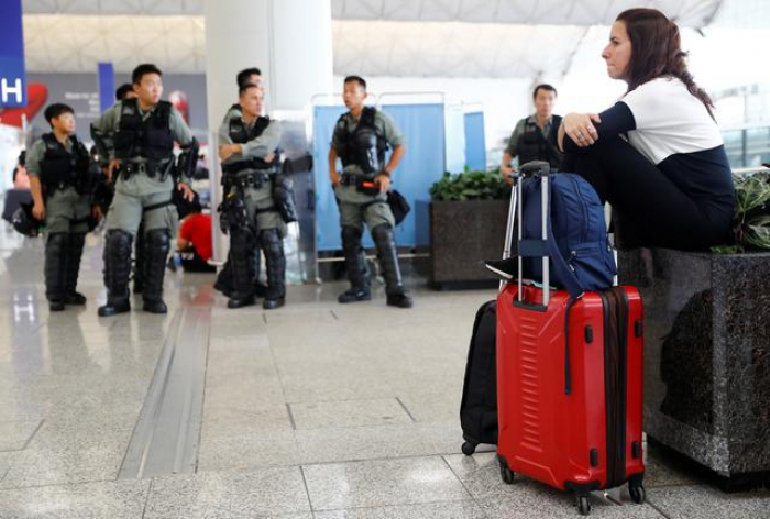 Hong Kong police stave off airport protest after night of violence