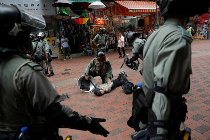 Hong Kong protesters, police in chaotic clashes, as metro, shops targeted