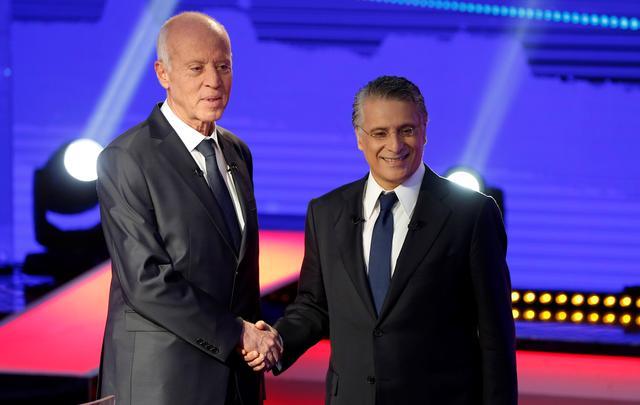 Tunisians vote for president, choosing between media mogul and retired professor