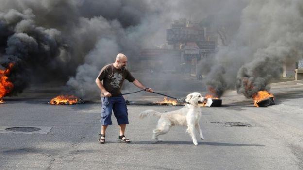 Lebanon scraps WhatsApp tax as protests rage