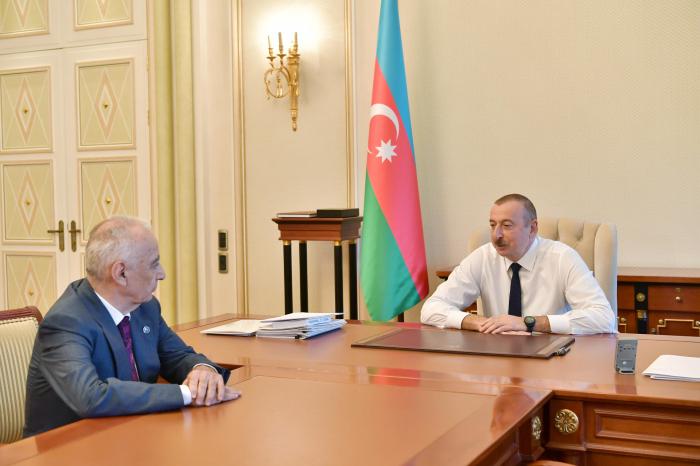 President Ilham Aliyev receives Deputy PM Hajibala Abutalibov as he submitted his resignation