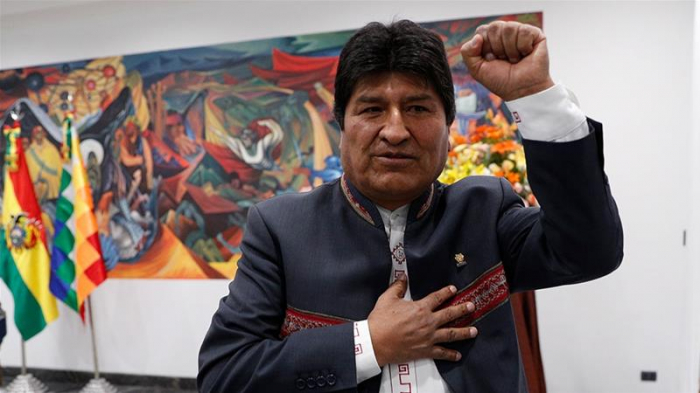 Shadow hangs over Bolivian elections as Morales scores first-round win