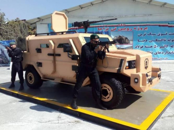 Iran unveils armored vehicle, smart robot