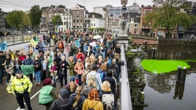 Dutch police arrest 130 climate protesters in Amsterdam