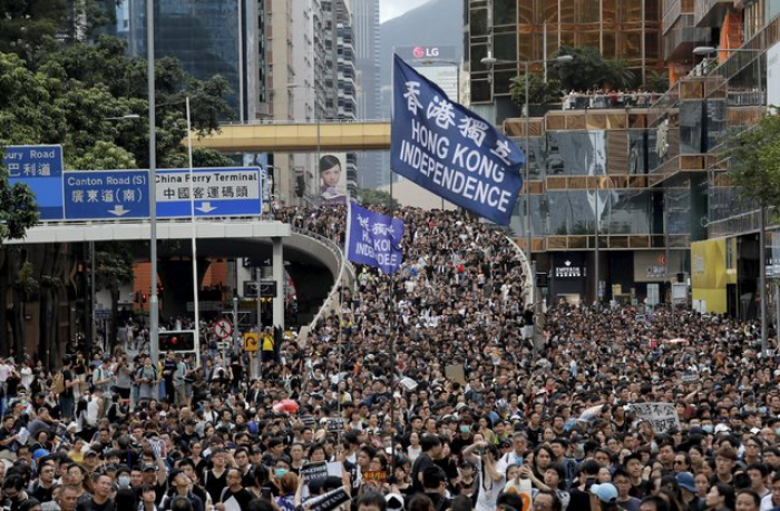 Hong Kong enters recession as protests again erupt in flames