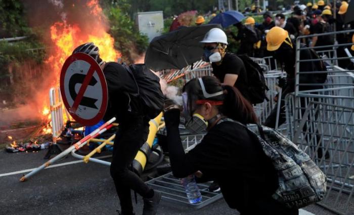 Hong Kong police shoot teen protester as violence escalates