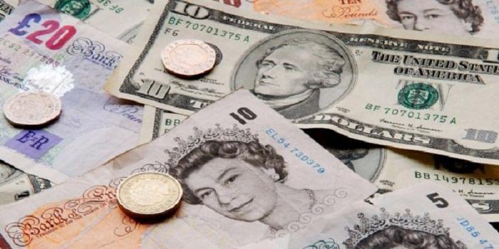 La livre sterling baisse face au dollar avant des votes décisifs au Parlement