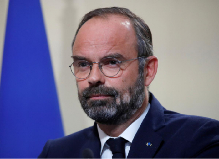 France under pressure from right wing, toughens stance on immigration